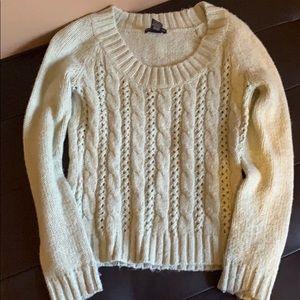 Soft, light green sweater